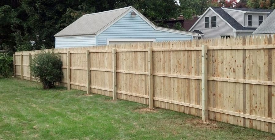 A wood fence installation is a great way to increase the amount of privacy  around your home. It is not only practical but also adds curb appeal. - How Much Will A Wood Privacy Fence Cost? - Fence It In